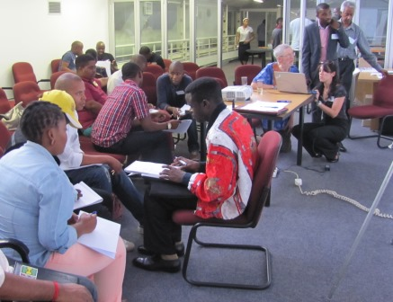 Participants and staff working in groups